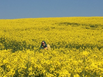 Luke made me pose. I think I'm trying to be a small animal here. This is in a field of the unfortunately named Rapeseed, aka Canola.