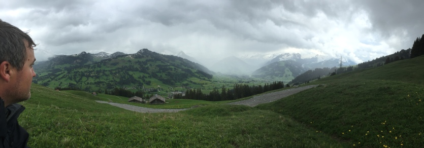 Mountains in Switzerland. Luke's head is wet from rain.