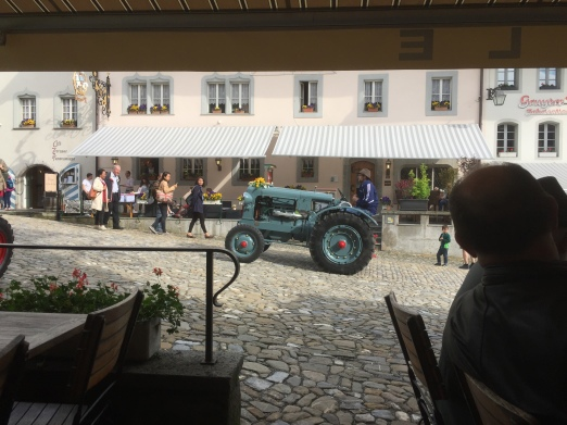 There was a cheese and cream festival on while we were in Gruyeres, and it included an old tractor exhibition. This one drove past us while we binged on melted cheese.