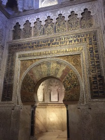 Beautiful arabic writing over the door to where the Quran was held (it is now empty)