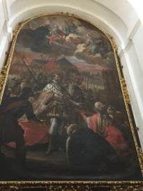 The beautiful white dome houses many expensive treasures, including this painting. It's a picture of a Christian king, clothed in riches with Muslim emirs begging him to take the keys to their beautiful city of Cordoba. This is right next to a painting of our suffering, naked Christ dying on the cross for our sins.