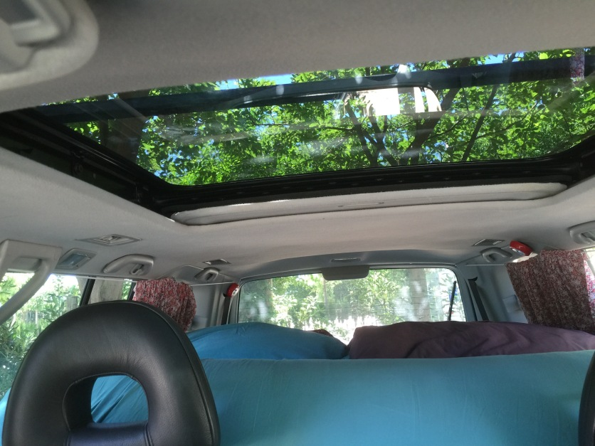 Another shot of the car, packed up to go. As you can see the mattress folds up at the end, so that we can push our chairs all the way back but still see out of the rearview mirror.