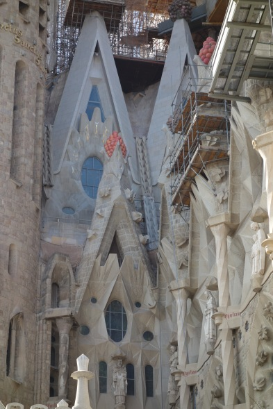 Look at them grapes. On a cathedral.