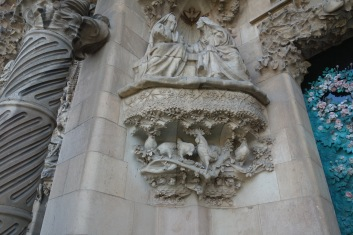 Gaudi put chickens on the nativity facade. Apparently they took plaster casts of actual live animals to do this. I think our chickens would have performed this job admirably.