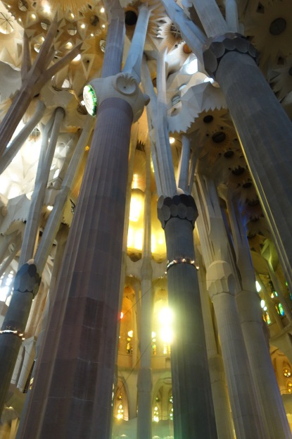 Heavenly light shines through the columns.