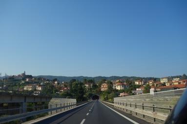 On a bridge, headed towards a tunnel