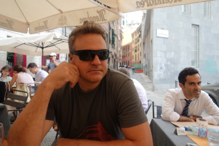 Look at the Italian businessman judging us in the background.