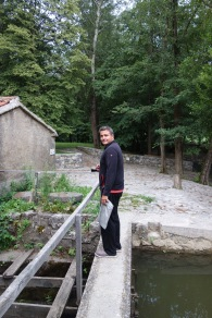 Skocjan, Slovenia: Walking across a dam over a creek at our campsite, to the firepit.