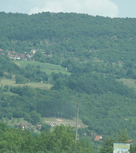 "Note on this hillside in the Republika Srpska, towards the bottom - an enormous monument to Tito. Tito was the ""benevolent dictator"" who kept Yugoslavia together until his death in 1980. This is simply what I've read - my interpretation may be controversial."