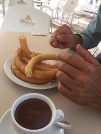 Churros in chocolate to kick off a day of intensive tourism in Granada