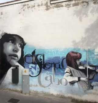 Girl playing the violin: not your average street art.