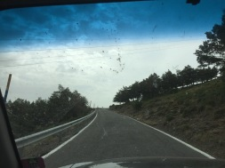This is the drive down. You get to see our dirty windshield too, lucky you. Do you see how this is only one lane? And it drops into the end of the world!