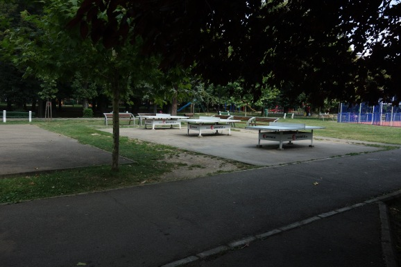 It's right across the street from this park! With ping pong tables!