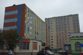 One thing we've noticed about Soviet, or Soviet-inspired, mega-buildings is that people often try to use paint to make them less ugly. If you've just gota big concrete rectangle to work with, architecturally, this is a nice cost-effective way to make it slightly less blrghh, we think.