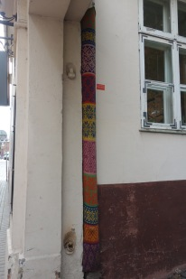 And quirky! Someone knit-bombed this down-pipe!