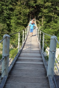 Mom is making it over the suspension bridge. It bounced. She was brave.