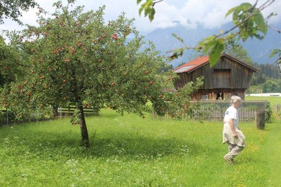 Huberta showing us around the idyllic land behind their house