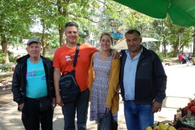 Our friends in the Ostashkov market, who were convinced we were British. They insisted upon a series of photos with different market guys.