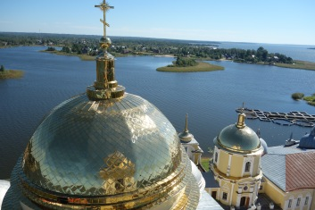 A gorgeous view of the monastery and lake. Notice those little fish farms down there!
