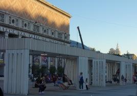 Grown ups swinging on public swings in Moscow. Delightful, Moscow, delightful!