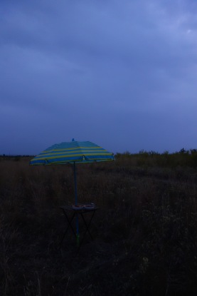Rain was threatening at our last campsite in Russia, so we put up our sun umbrella. I'm sure it was very depressed by this use.