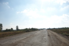 The road to the major boarding crossing between two large cities - Orenburg in Russia and Aktobe in Kazakhstan.