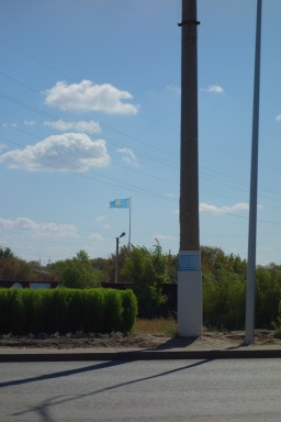 Our first Kazakh flag. You can see why, from the pictures of the steppe, the flag is blue and yellow - it's all just yellow grass and blue sky, as far as the eye can see.