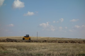"""Lots of road building in Kazakhstan, too. They often just block off the paved road, so the machines can work in peace, and provide a parallel """"flattened"""" dirt road for our convenience."""