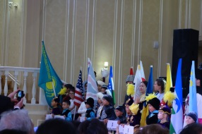 One musician per country marched in, in their traditional costume. They were each led by an adorable Kazakh kid. And look - America turned out! And musicians, guess what she was wearing - white on top, black on bottom, of course. That was like my second skin as a kid.