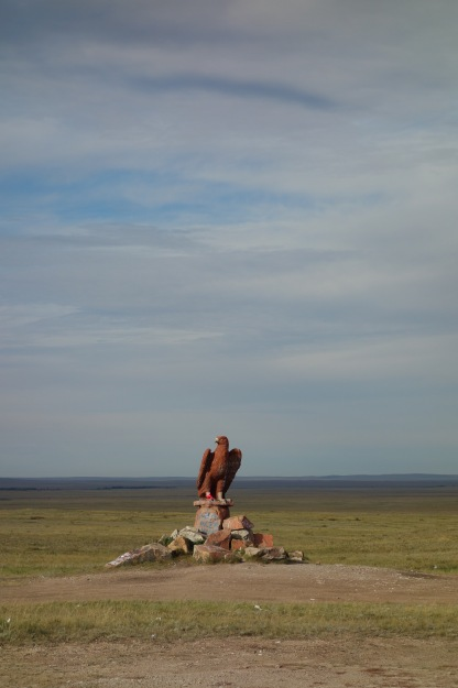 An eagle sculpture on the steppe