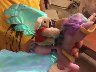 She's got her Australian koala riding her pegasus. Very creative toy usage; I approve.