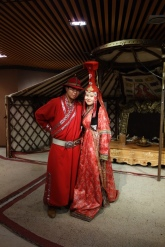 Some folks dressed up in traditional outfits in the museum accompanying the Chinggis status