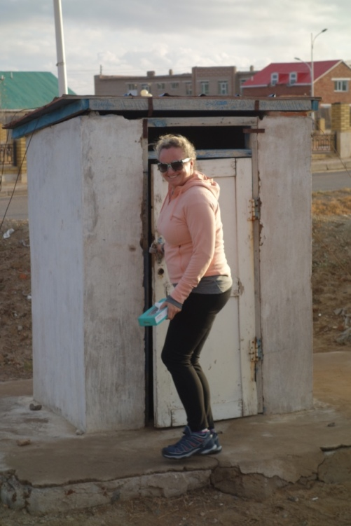 Jo is about to experience her first drop-toilet. We wanted to capture the moment.