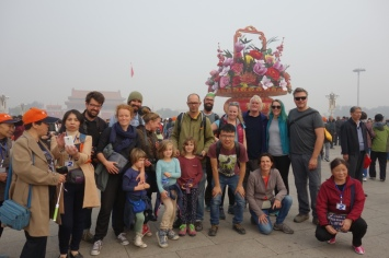 Our group (minus a few) at Tiananmen Square. We couldn't even get a group photo without people inserting themselves. Seriously, we don't have a group photo without other people crouching in front.