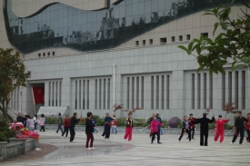 "On the road to Chengdu, the group camped near this sports centre where the ""dancing grannies"" (real phrase) were doing their thing. This is everywhere in China."