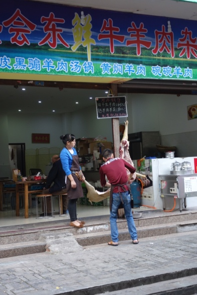 What is it with Chinese folks liking to do their pig butchering in public? Perhaps it convinces the clientelle that the meat is fresh.