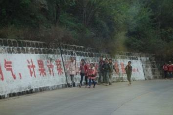Schoolchildren walking on the highway near Lugu Lake