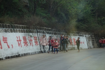 Schoolchildren walking on the highway near Lugu Lake