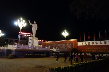 Dancing grannies with the Mao statue