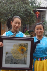 Two of the embroiderers in their family courtyard. The one on the right went to university to study English.