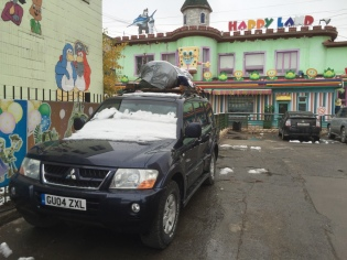 We parked our car across the street in this guarded car park in the children's playplace, because the parking lot behind our guesthouse was full of permanently drunk people, at least 5 at a time.