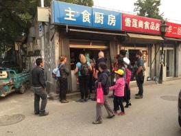 Crowding around a food vendor.
