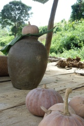 Pottery made from the local clay soil, with rice whisky inside.