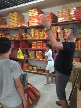 Luke, in the process of buying the second batch of fireworks. Look at that shop attendant with her hand to her face. She did that the whole time.