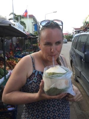 Jo enjoys a fresh coconut just inside of Laos