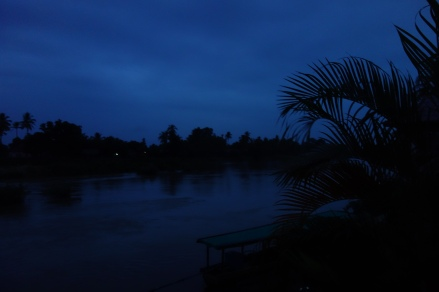 We got up at 5:45am (that's in the morning, folks) to see the rare Irrawaddy dolphins on the river. This dark view from our bungalow porch is proof of this deed.