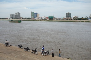 Dudes and their bikes fishing on the riverside