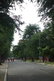 A quiet, blocked off street, with monks