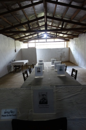 The grand Politburo meeting room: this is where the resistance was based. The leaders (pictured at their seats on the table) drove through bombs to meet.