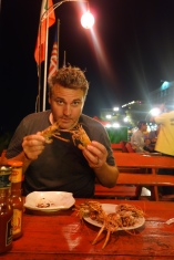 Eating crab by the Mekong, at a strip of BBQ restaurants with twinkling lights and acoustic Chinese hits